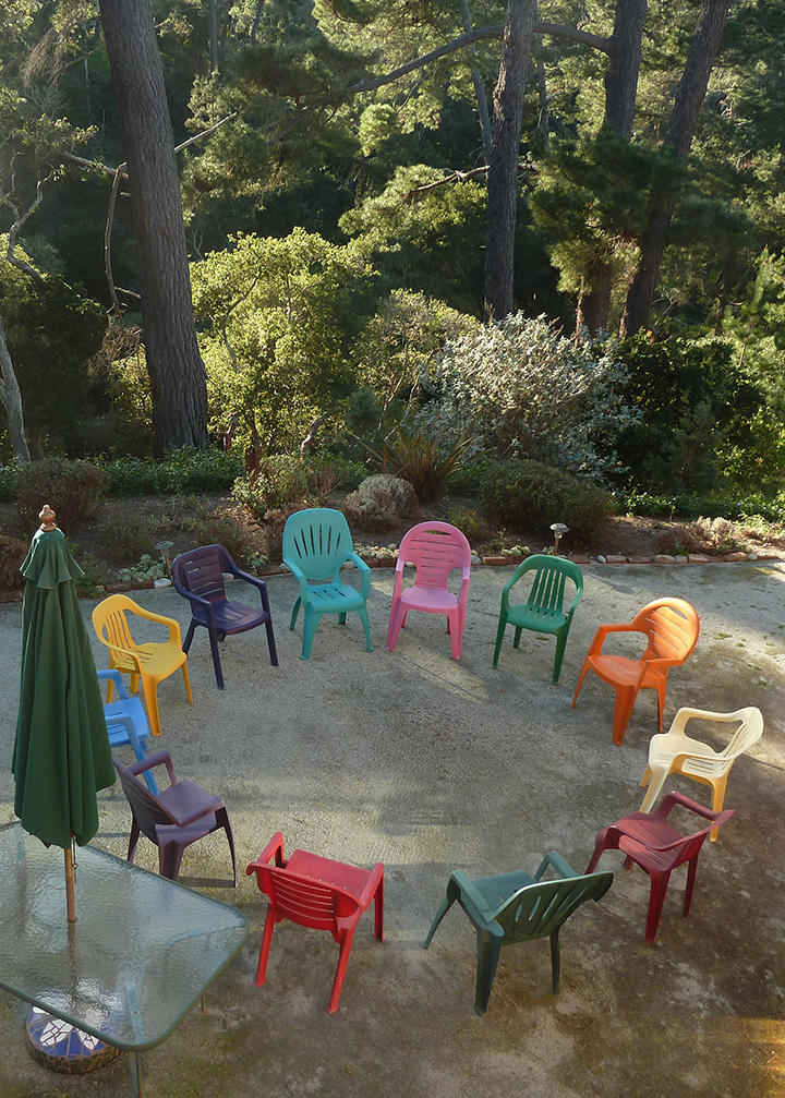 A circle of multi-colored chairs